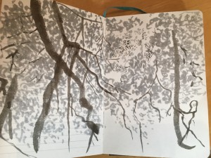 Photograph of sketchbook page of monotone drawing of branches, light and leaves